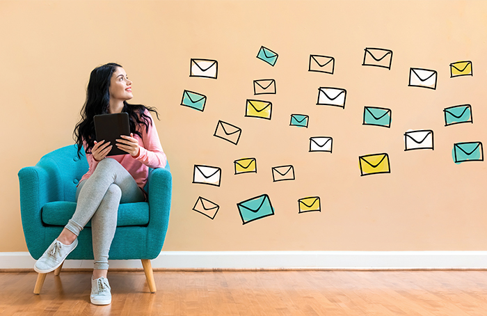 Woman Looking at Graphic Envelopes