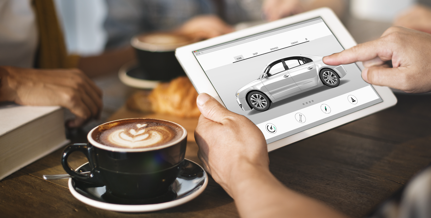 Viewing an Image of a Car on a Tablet